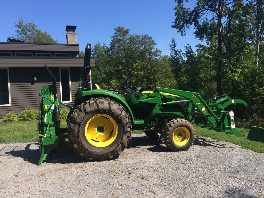 "Dressed for forest duty with a Wallenstein FX90 and John Deere 60"" root grapple"
